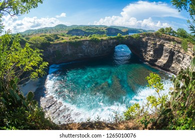 Rock coastline. Stone arch over the sea. Broken beach, Nusa Penida ,Indonesia.