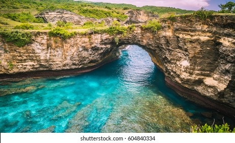 Rock coastline. Stone arch over the sea. Broken beach, Nusa Penida ,Indonesia.