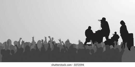 Rock concert silhouette with jam packed crowd.