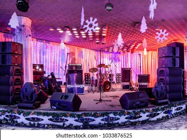 Rock concert stage with musical instruments in nightclub in New Year's Eve