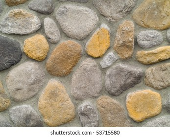 Rock and Concrete Wall with Large Rounded Stones
