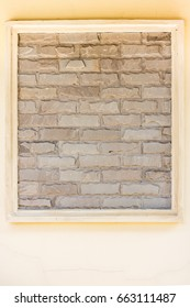 Rock design on a wall. The decoration with natural stone in frame.