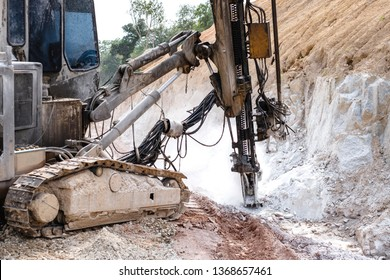 Rock driller on road comnstruction. Drilling rock in the works of creating a road.