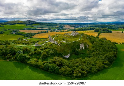 The Rock of Dunamase is a rocky outcrop in County Laois the ruins of Dunamase Castle, a defensive stronghold dating from the early Hiberno-Norman period.