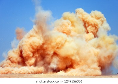 The rock dust clouds after the blast on the mining site