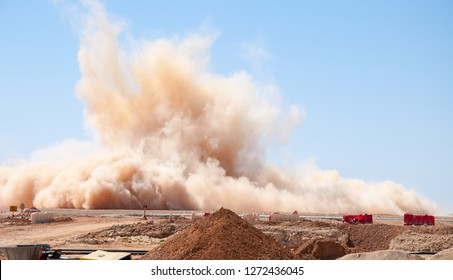 Rock dust clouds after the blast on the construction site