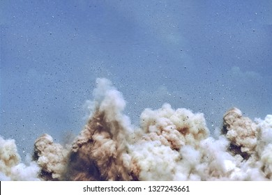 Rock dust clouds during detonator blast on the construction site