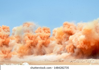 Rock dust clouds during detonator blasting on the mining site