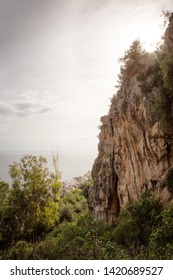rock face cliff top with forest below in spain