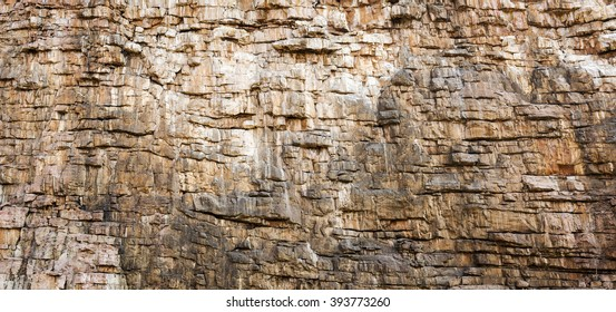 Rock face texture of large rocky cliffs