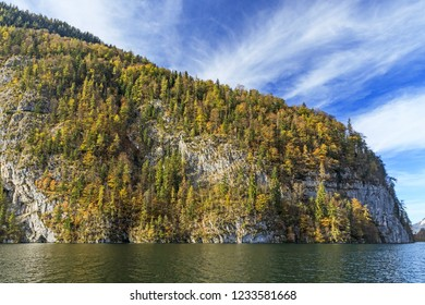 Rock faces at the mountain lake Koenig, Königssee with mountain forest with autum foliage in Bavaria, Germany. Berchtesgaden National Park, Kreuzelwand.