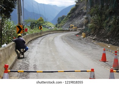 Rock fall destroy road during landslide after heavy rain,broken road by an earthquake or landslide asphalt road on the hillside sliding earth in way to Alishan Park Taiwan,Stop Transportation traffic.