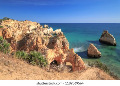 Rock formation at the beach Praia Dos Tres Irmaos on the Algarve coast between Alvor and Portimao near Lagos