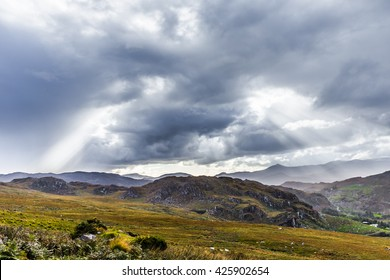 Rock formation landscape in Kerry in Ireland with massive clouds and sun rays