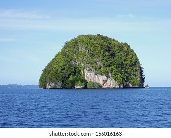 Rock Formation in Sea with blue sky.