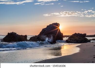 Rock formation with sunburst.