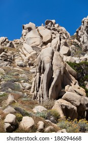 Rock formations in Capo Testa, Sardinia, Italy. Mediterranean coast.Natural monument. Sardinia nature with the space for advertising text,stones,rocks in blue clear sky background, summer in Sardinia