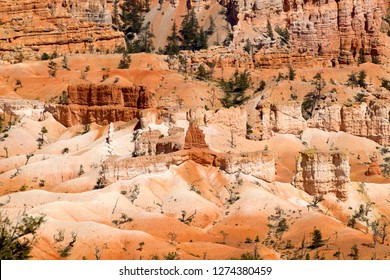 """Rock formations and hoodoos, Sunset Point, Bryce Amphitheater, Bryce Canyon National Park, Utah, USA. Hoodoos are tall skinny spires of rock that protrude from the bottom of arid basins and """"broken"""" l"""