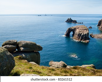 Rock formations off the coast at Lands End Cornwall England UK