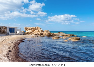 Rock formations on Firiplaka Beach, one of the most popular beach situated at the southern side in Milos island. Cyclades, Greece.