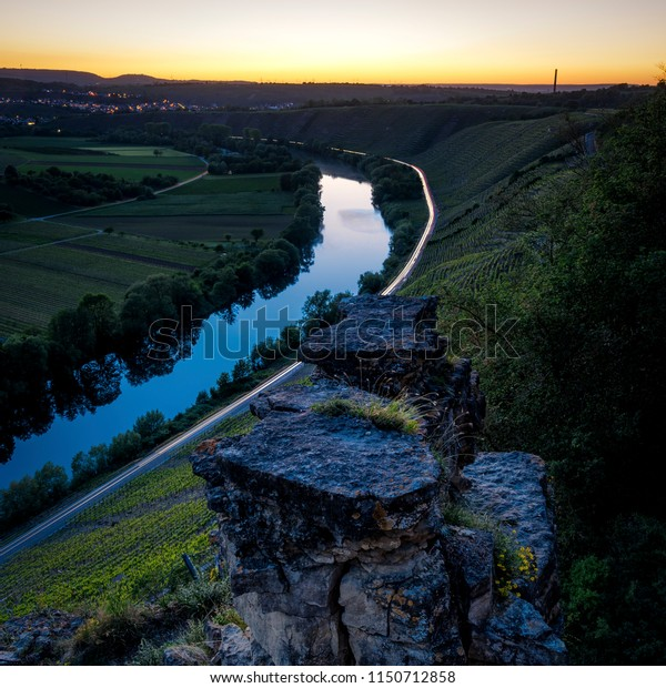 Rock formations with a river and light trails of cars passing by in Hessigheim, Germany