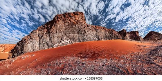 Rock formations and sand dune in the desert of Death Valley (Valle de la Muerte), San Pedro de Atacama, Chile.