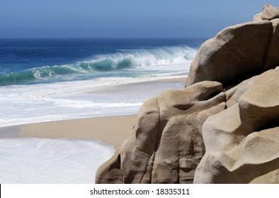 Rock formations sculpted by waves on Lovers' beach in Cabo San Lucas, Mexico.
