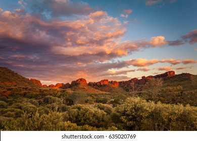 Rock formations surrounding the Kings Canyon car park at sunset,  Central Australia, Northern Territory, Australia