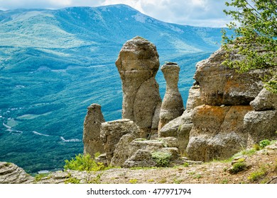 Rock formations of the Valley of Ghosts on Demerdji mountain in summer, Crimea, Russia. It is a natural tourist attraction of Crimea. Scenic view of fancy rocks in South coast of Crimea on sunny day.