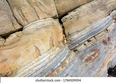 Rock formations with various strata by the beach between the Fife villages of St Monans and Pittenweem on the Firth of Forth, Scotland forming part of the Pittenweem formation