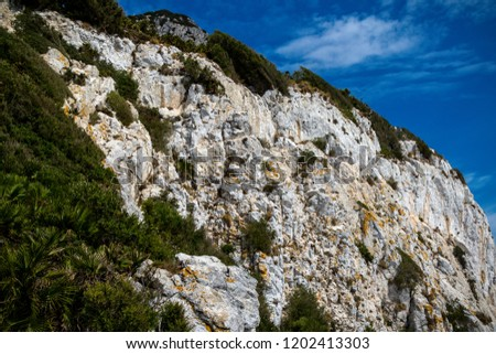 The Rock of Gibraltar. Gibraltar is a British Overseas Territory located on the southern tip of Spain
