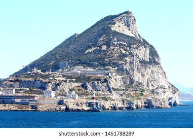 The Rock at Gibraltar City Ocean View. British Territory. Lighthouse and Mosque in foreground.