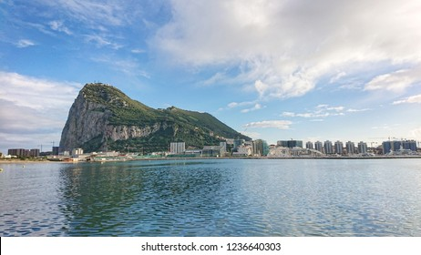 the Rock of gibraltar mountain, city and peninsula with the Marina and blue sky view from Spain