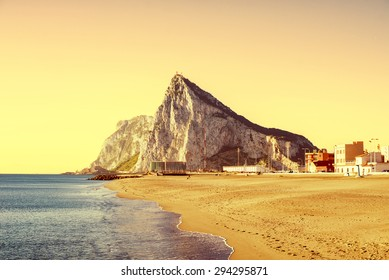 The Rock of Gibraltar at sunset, as seen from the beach of La Atunara, in La Linea de la Concepcion