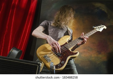 rock guitar player on stage with amp