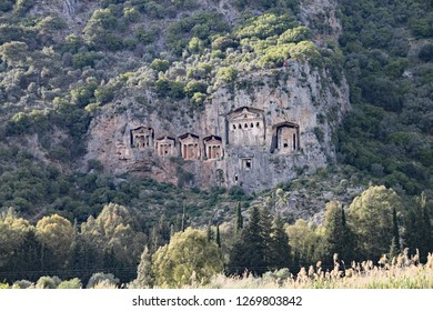 Rock hewn Lycian tombs carved in the cliff face in Dalyan Turkey