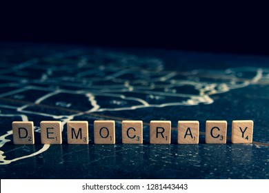Rock Hill, SC/USA - 1/11/2019: Democracy spelled with Scrabble tiles on map of United States