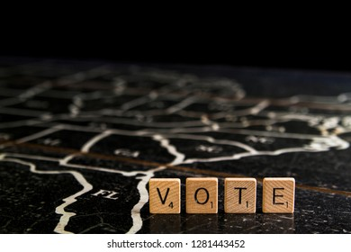 Rock Hill, SC/USA - 1/11/2019: Vote spelled with Scrabble tiles on map of United States