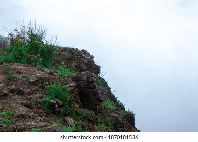 Rock hills on the mountain with white fog.