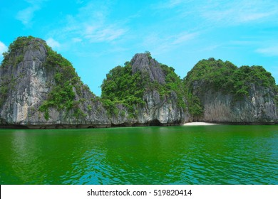 Rock islands in Halong Bay, Vietnam, Southeast Asia. UNESCO World Heritage Site. Scenic landscape with limestone mountains and sea at Ha Long Bay. Most popular landmark, tourist destination of Vietnam