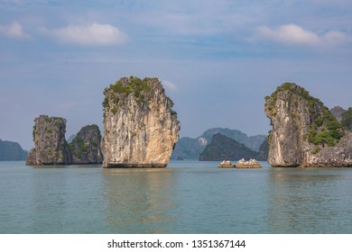Rock islands near floating village in Halong Bay, Vietnam, Southeast Asia.