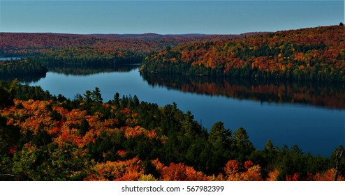 Rock Lake is one of the beautiful lakes inside Algonquin Provincial Park in Huntsville, Ontario, Canada.  It also has one of the best lookout trail for the best view during Autumn season.