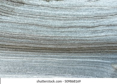 Rock layers - gray formations of rocks. Light background with dark lines.