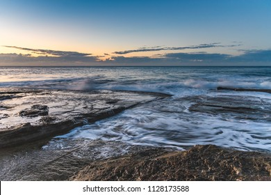 Rock Ledge Seascape - Capturing the sunrise from The Skillion at Terrigal on the Central Coast, NSW, Australia.
