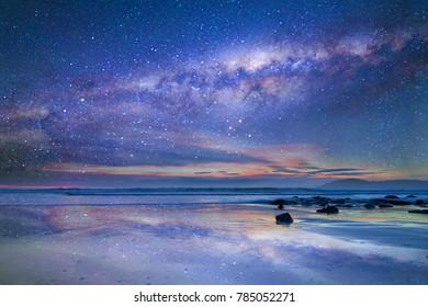 Rock with milkyway background at Moeraki Boulders, New Zealand.