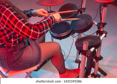 Rock, music and hobby concept - drummer's foot wears sneakers pushing drum bass pedal