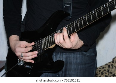 rock musician with a guitar in his hands