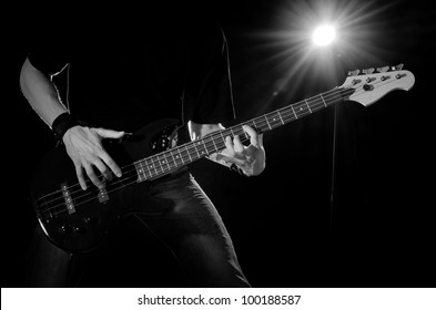 rock musician with guitar on dark stage