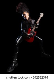 Rock musician in leather clothing isolated on black