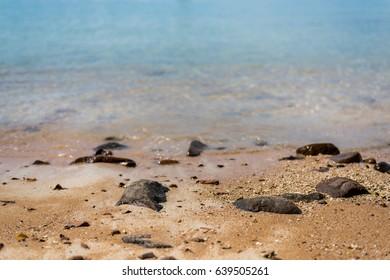 Rock on the beach selective focus